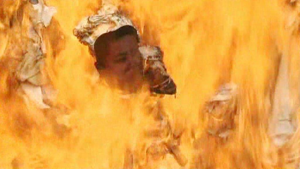 Hořící podobizna Kim Čong-una