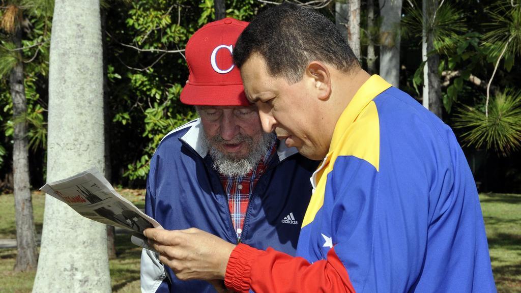 Hugo Chávez s Fidelem Castrem