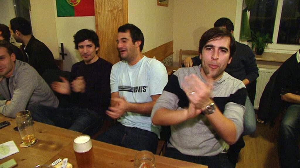 Návštěvníci portugalské kavárny