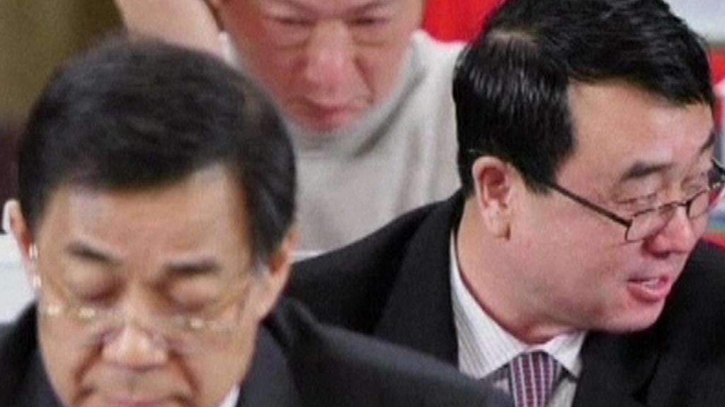 Po Si-laj (vpředu) a Wang Li-jün (vzadu)