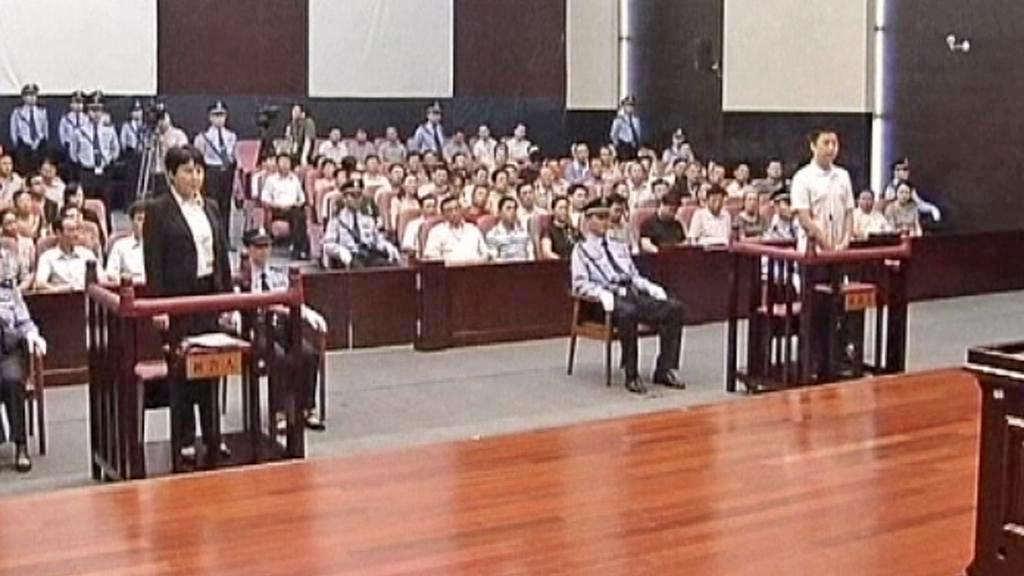 Ku Kchaj-laj a Čang Siao-ťün před soudem