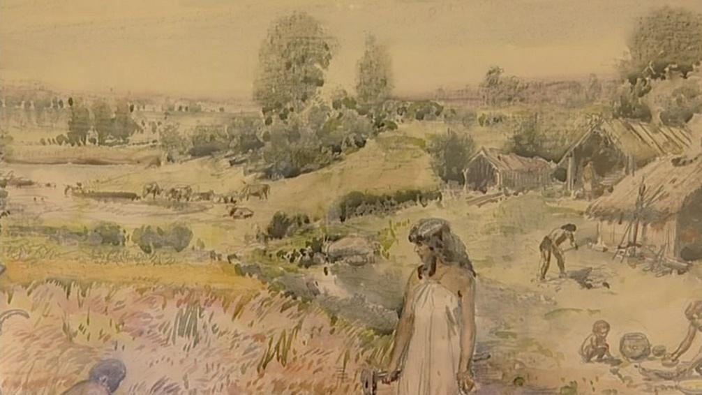 Burian ve skice vyměnil tradiční role. Žena drží sekyru, muž mele obilí