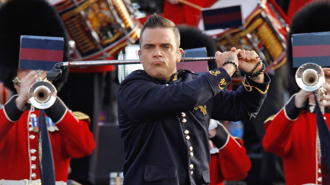 Robbie Williams zahájil koncert na počest Alžběty II.