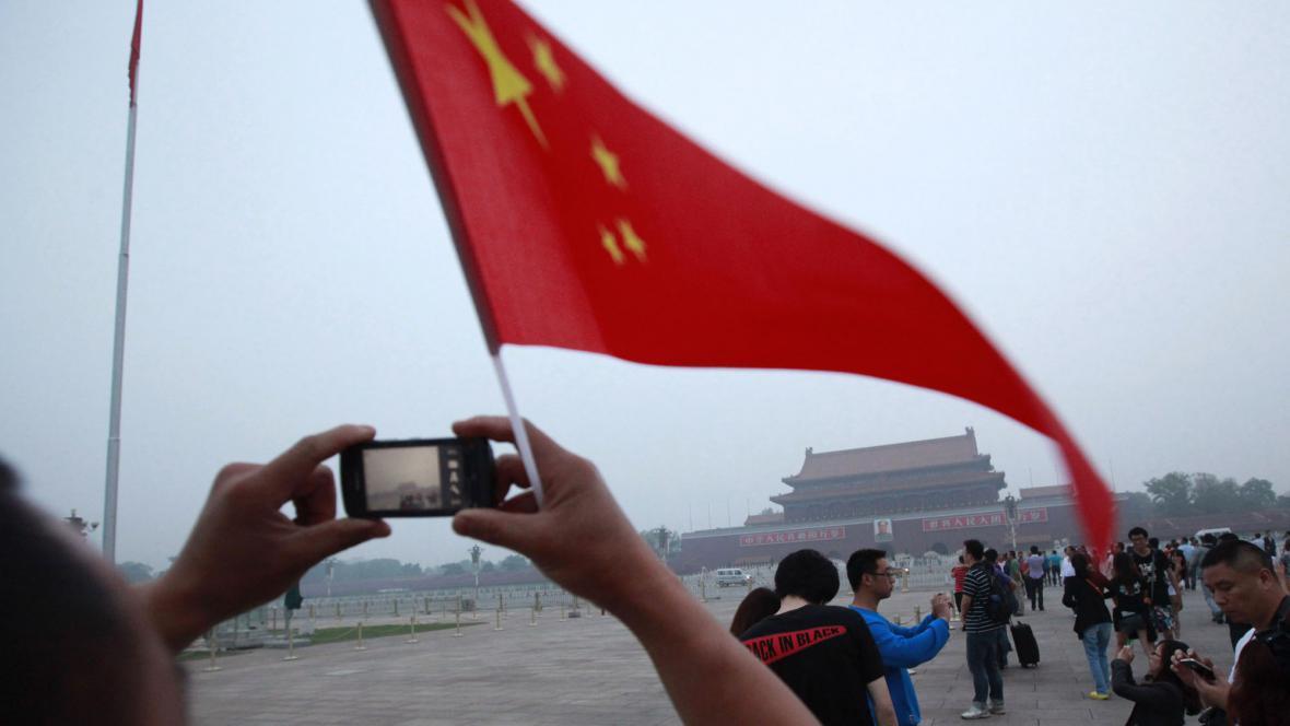 Turisté si fotografují náměstí Tchien-an-men