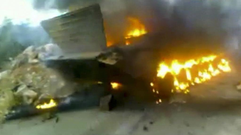 Hořící syrský tank
