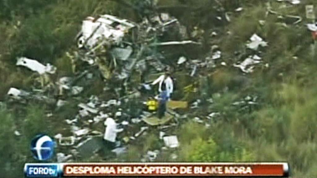 Trosky vrtulníku, v nichž zahynul ministr Blake