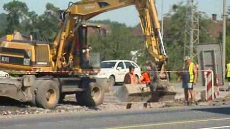 Stavba omezující provoz na silnici
