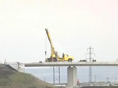 Stavba silnice u Hulína