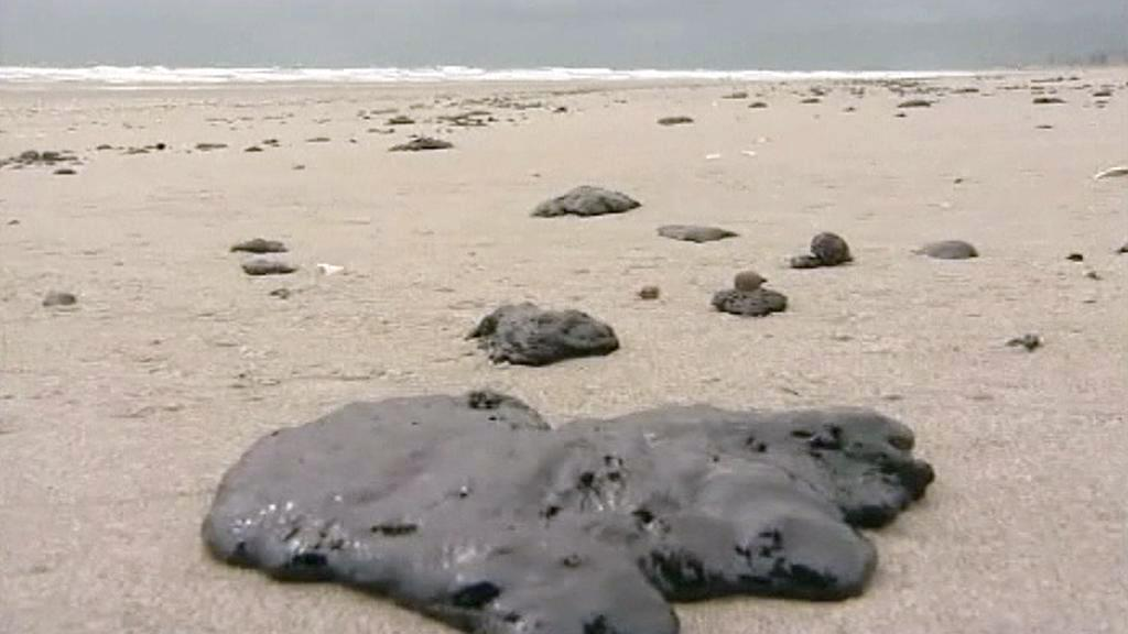 Dehtové koule na pláži Mont Maunganui