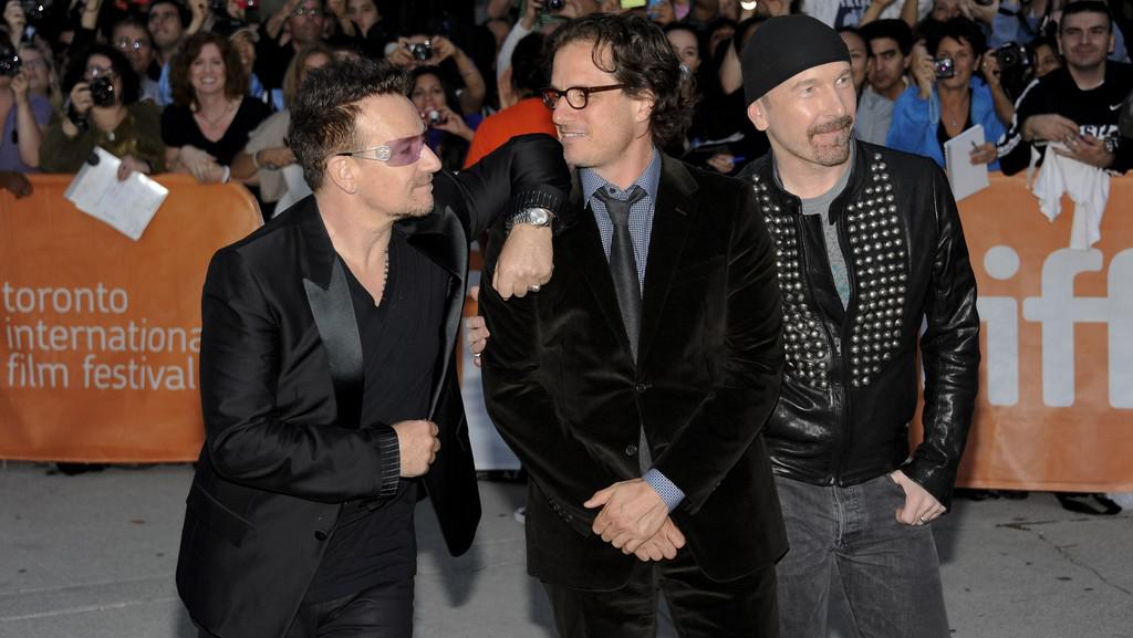 Bono a The Edge z U2 a režisér Davis Guggenheim