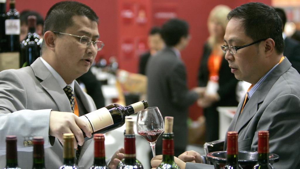 Čínští obchodníci s vínem