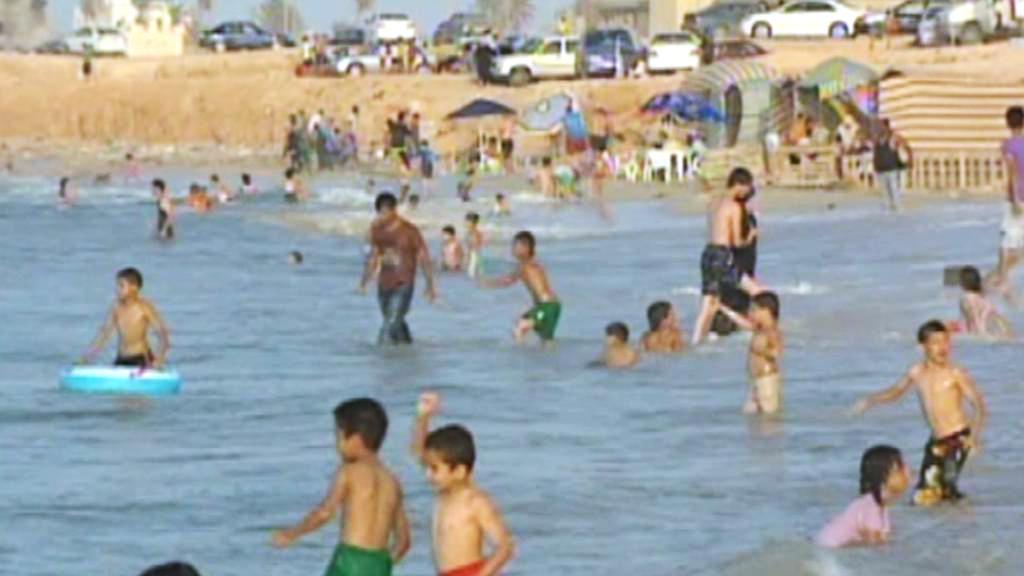 Libyjci na pláži