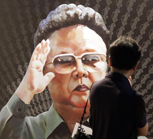 Severekorejský vůdce Kim Čong-il na plakátě