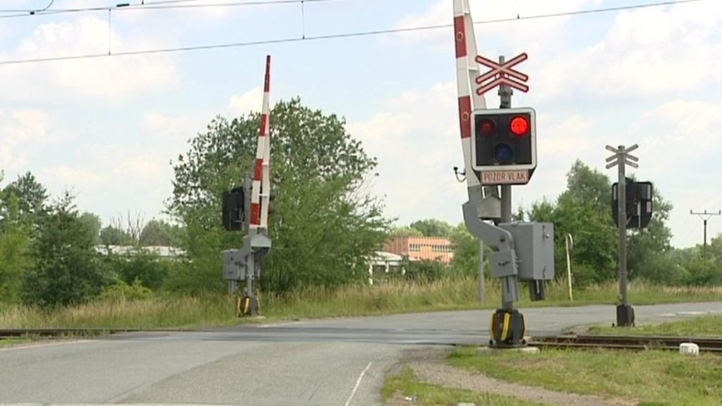 Výstražné znamení na železničním přejezdu