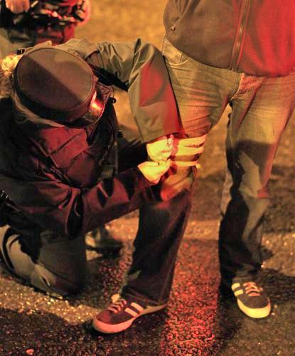 Noha postřeleného fotografa agentury PA