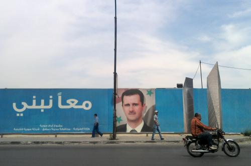 Plakát prezidenta Asada v Damašku