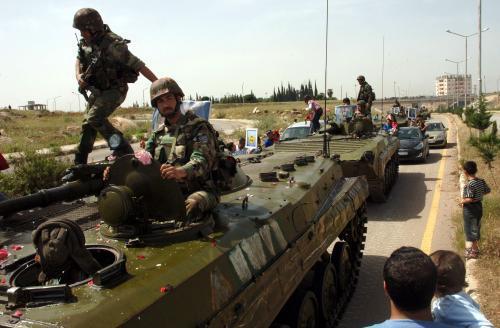 Syrští vojáci na tanku