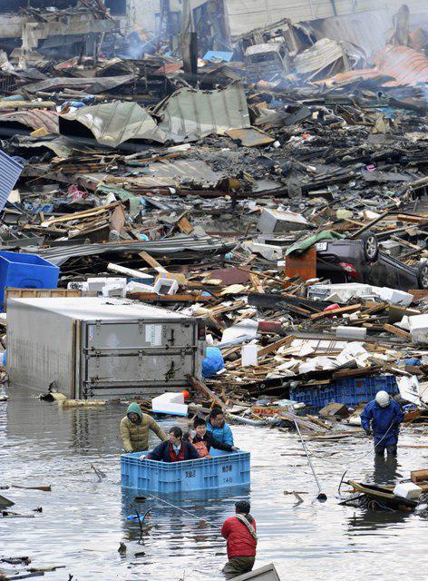 Následky vlny tsunami ve městě Kesennuma