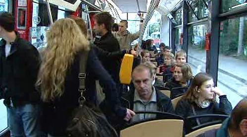 Cestující v tramvaji