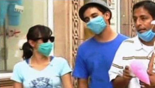 Roušky chrání před prasečí chřipkou