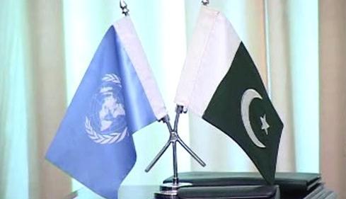 Vlajky OSN a Pákistánu