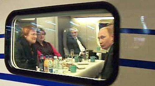 Ruský premiér Vladimir Putin a finská prezidentka Tarja Halonenová