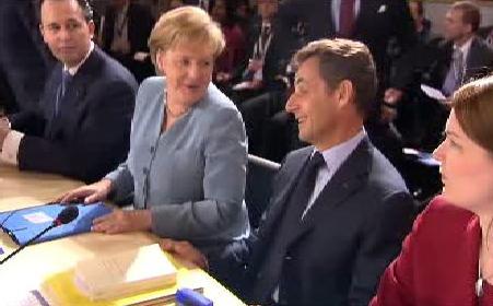 Merkelová a Sarkozy