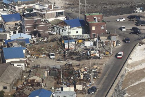 Poničené domy po střelbě