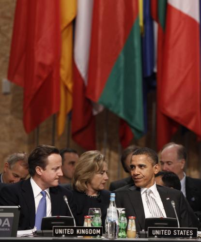 David Cameron, Hillary Clintonová a Barack Obama