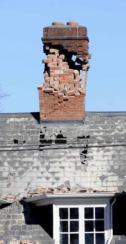 Poškozený dům ve městě Christchurch