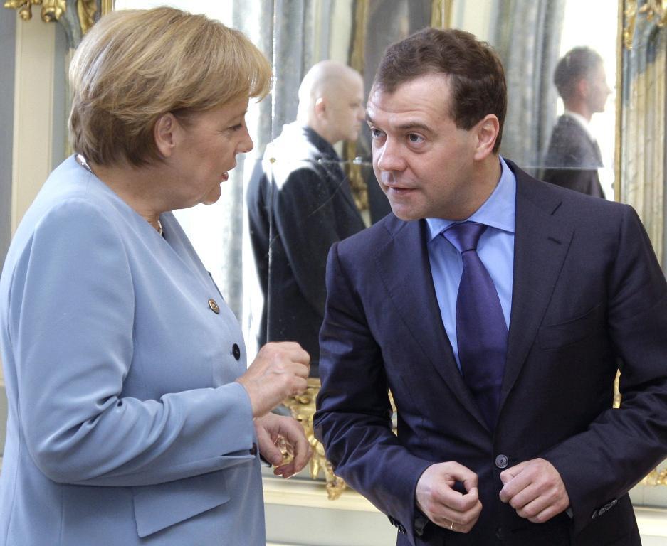 Dmitrij Medvěděv a Anglela Merkelová