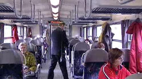 Cestující ve vlaku