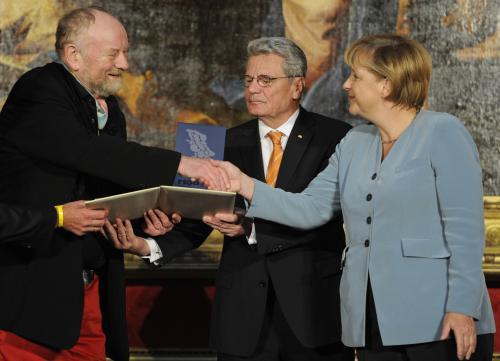 Kurt Westergaard a Angela Merkelová