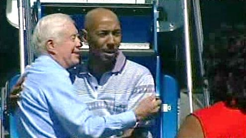 Jimmy Carter a Aijalon Mahli Gomes po přistání v Bostonu