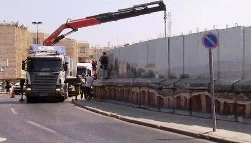 Odstraňování zdi kolem předměstí Gilo