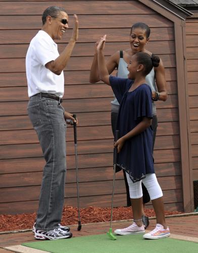 Obamovi hráli na Floridě golf