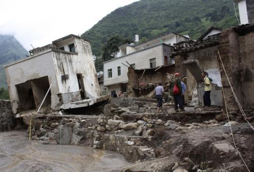 Následky sesuvů půdy v Číně