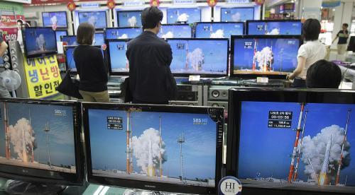 Jihokorejci sledují start rakety