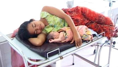 Kambodžská žena po porodu