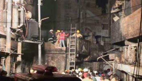 Následky požáru v Dháce
