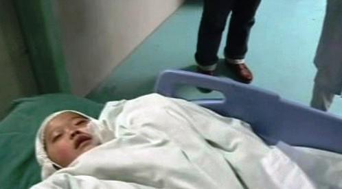 Zraněné čínské dítě