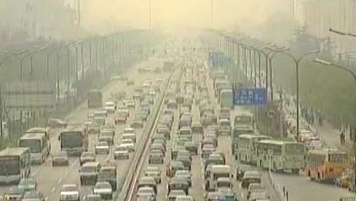 Smog z husté automobilové dopravy