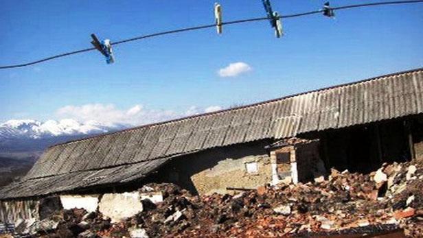 Zničený dům v Ingušsku