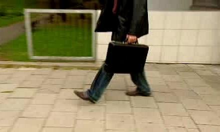 Muž s kufříkem