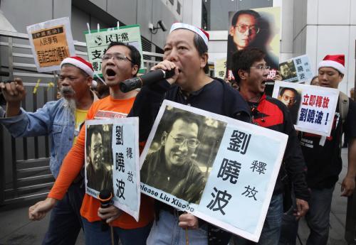 Protesty proti soudu s čínským disidentem
