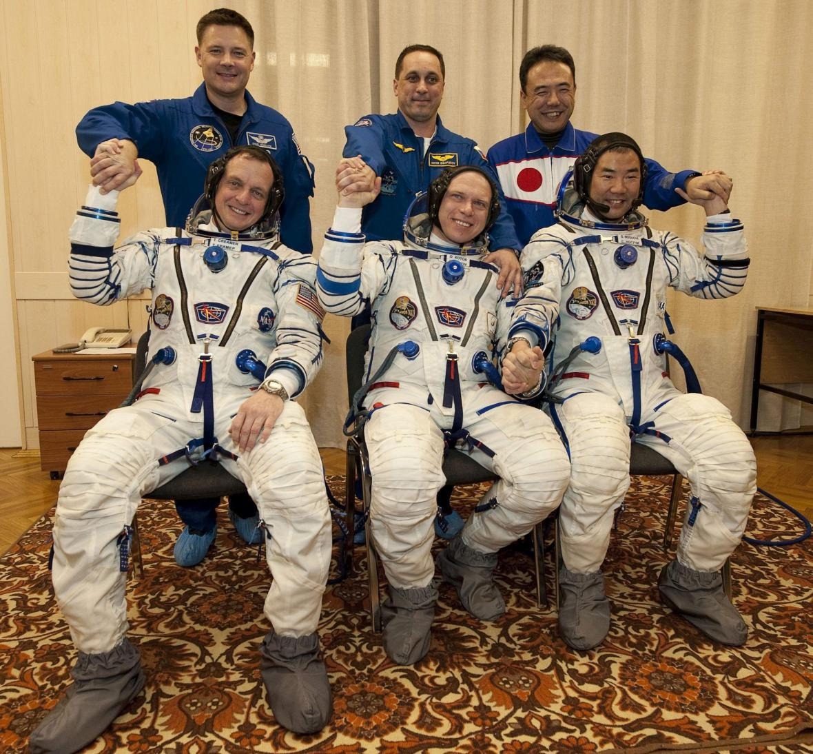 Posádka raketoplánu před odletem