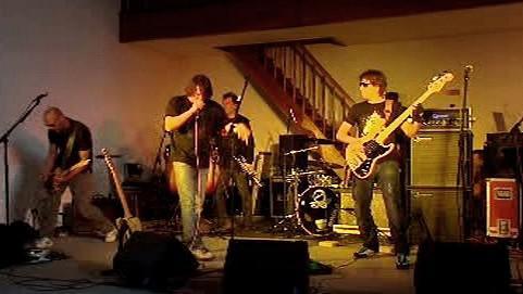 Koncert skupiny Chinaski v pankrácké věznici