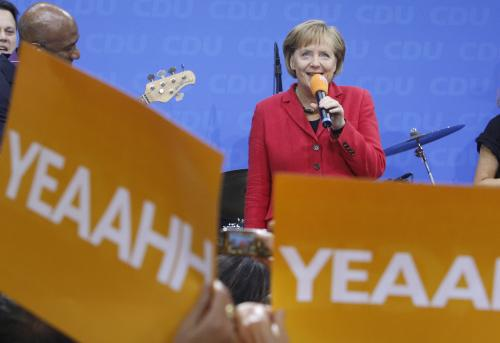 Slavící Angela Merkelová
