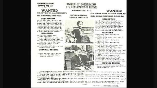 Dobový plakát informující o hledání dvojice zločinců