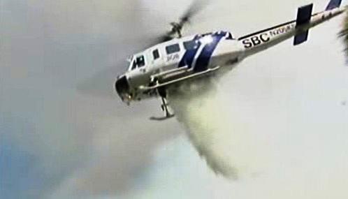 Hašení požáru z vrtulníku